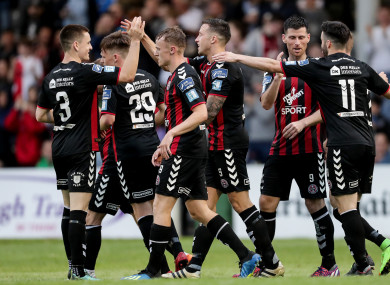 Rob Cornwall celebrates with team-mates at Dalymount Park on Friday.