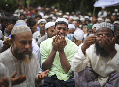 Thousands of Rohingya Muslim refugees on Saturday marked the one-year anniversary of the attacks that sent them fleeing to safety in Bangladesh, praying they can return to their homes in Myanmar and demanding justice for their dead relatives and neighbors.