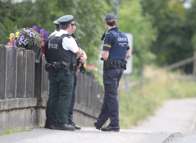 Members of the PSNI and the Gardai stand exactly on the border in Belleek, Co Fermanagh.