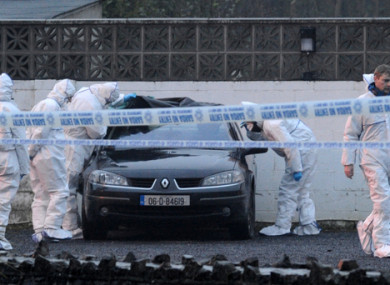 Gardaí examine a car at the scene of the fatal shooting at The Huntsman Inn in 2013.