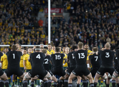 The Wallabies watch the All Blacks do the haka yesterday.