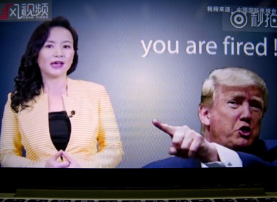 An online video about US-China trade tensions produced by China's state television broadcaster plays on a computer screen in Beijing today.