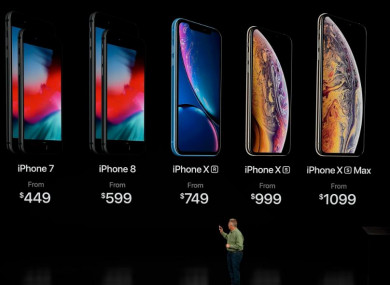 Phil Schiller, Apple's senior vice president of worldwide marketing, speaks about the prices of the newly released iPhones at the Steve Jobs Theater in Cupertino, California.