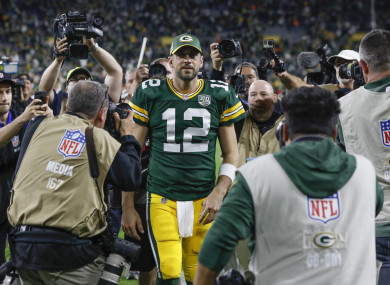 Green Bay Packers' Aaron Rodgers walks off the field.