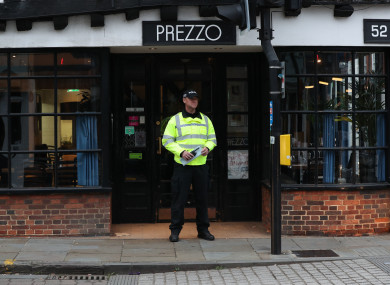 A police officer outside the Prezzo restaurant in Salisbury, where a couple had become unwell after exposure to an unknown substance.