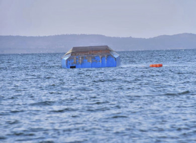 The upturned passenger ferry MV Nyerere floats in the water near Ukara Island in Lake Victoria.