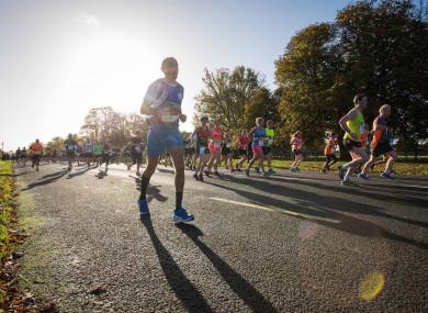 Runners run through Dublin's Phoenix Park.