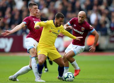 Declan Rice challenges Eden Hazard.