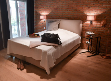 Germany, Berlin: A suitcase lies on the bed of an Airbnb rental apartment