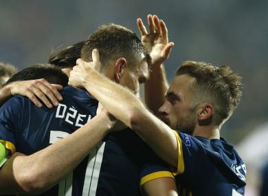 Edin Dzeko celebrates scoring for Bosnia and Herzegovina in Sarajevo on Monday.