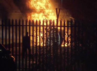 This image made from video shows a burning helicopter in a parking lot outside the King Power Stadium in Leicester.