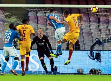 Arkadiusz Milik sends a header at goal for Napoli.