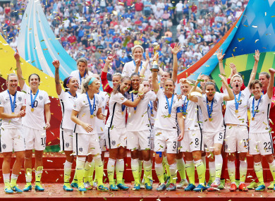 USA lift the World Cup trophy in 2015 after beating Japan in the final in Vancouver.