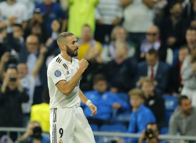 Karim Benzema celebrates scoring a goal.