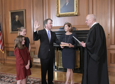 Retired Justice Anthony M. Kennedy, right, administers the Judicial Oath to Judge Brett Kavanaugh in the Justices' Conference Room of the Supreme Court Building