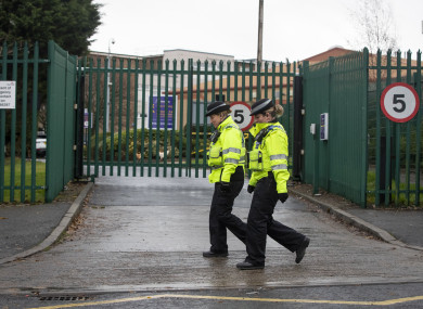 Police Community Support Officers walk past Almondbury Community School in Huddersfield where police are investigating a report of a