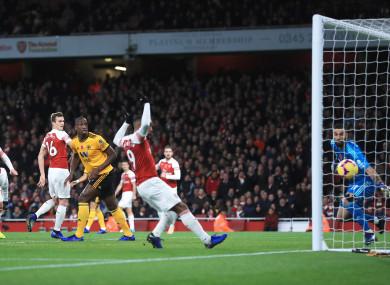 Arsenal's Henrikh Mkhitaryan (not shown) scores.