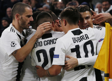 Juventus players celebrate after scoring against Valencia.
