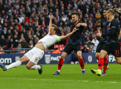Harry Kane stretches out to score against Croatia at Wembley.