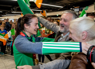 World champion Kellie Harrington is greeted by her parents Yvonne and Christy at Dublin Airport