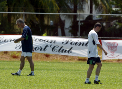 Manager Mick McCarthy and Roy Keane pass each other during training in Saipan prior to the 2002 World Cup.