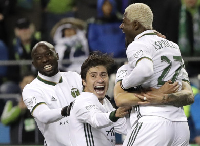Portland Timbers players celebrate after their shoot-out victory over Seattle Sounders.