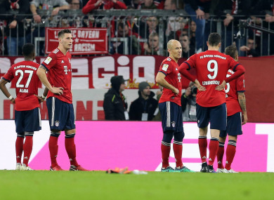 Bayern Munich players show their disappointment.