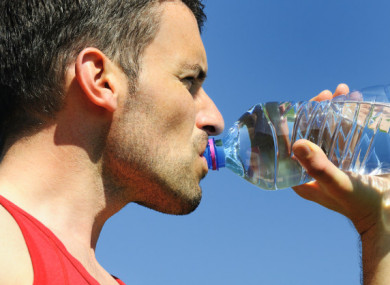 File photo of a man drinking water from a plastic bottle.