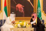 Mohammed bin Salman (known as MBS, right) receives Abu Dhabi's Crown Prince under a portrait of the Kingdom's founder, Abdulaziz Al Saud.