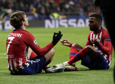 Antoine Griezmann and Thomas Lemar celebrate a goal for Atletico Madrid.