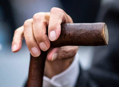 Johann Rehbogen holds his walking stick at the beginning of a trial in Muenster, Germany, last week.
