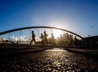 Runners cross over James Joyce bridge in the 2018 SSE Airtricity Dublin Marathon.