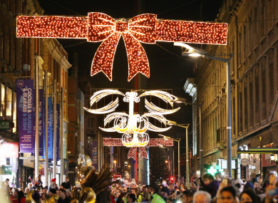 File photo of Christmas lights and shoppers in Dublin.