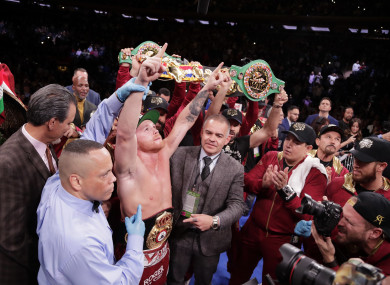 Alvarez celebrates after his WBA super middleweight championship win on Saturday.