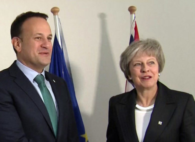 Varadkar and May greet each other in Brussels.