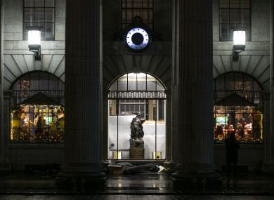 A person sleeps outside the GPO on O'Connell Street.