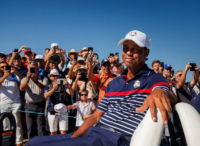 Fans watch on as Tiger Woods passes by in a buggy at the 2018 Ryder Cup.