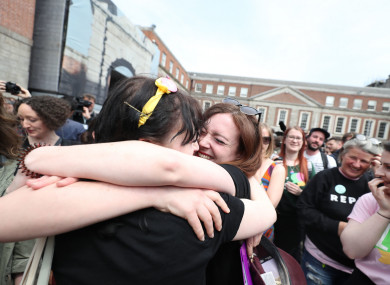 Members of the quartet Voices For Appeal embrace at Dublin Castle following the referendum result