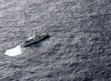 Japan's Coast Guard ship is seen at sea during a search operation for US Marine refueling plane and fighter jet off Muroto, Kochi prefecture, southwestern Japan