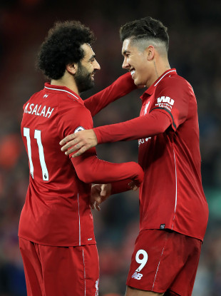 Mo Salah and Roberto Firmino celebrate after defeating Arsenal.