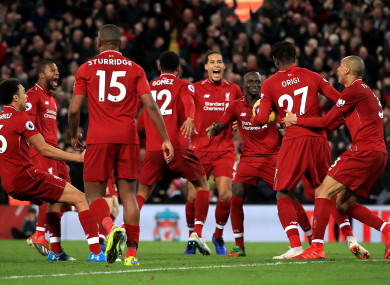 Liverpool players celebrate after Divock Origi's late winner on Sunday.