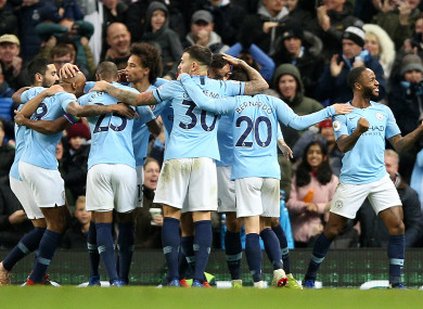 Manchester City's Raheem Sterling (right) celebrates scoring his side's second goal of the game.