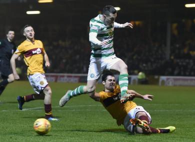 Motherwell's Carl McHugh tackles Celtic's Callum McGregor.