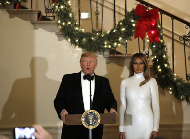 Donald J. Trump speaks as First lady Melania Trump looks on at the Congressional Ball at White House, 15 December 15.