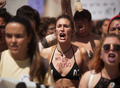 A protester with her body painted with the words: 'It is not abuse, it is rape' takes part in a demonstration in May against the sentence of five men (known as 'La Manada' or Wolf Pack)