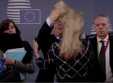 Juncker ruffling a woman's hair at a recent EU Summit.