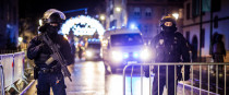 Policemen secure the entrance to the Strasbourg Christmas Market after three people were killed in a shooting attack