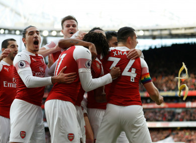 A banana skin is thrown onto the pitch as Arsenal players celebrate after their opening goal against Tottenham.
