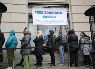 People wait in line at Chef Jose Andres' World Central Kitchen for free meals to workers affected by the government shutdown in Washington