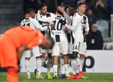 Juventus players celebrate Emre Can's goal against Chievo.